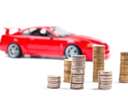 Coins and a red sports car